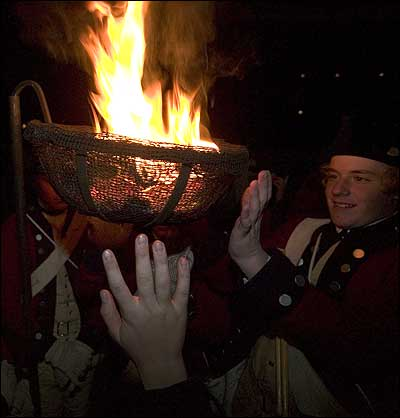 Warming hands by a cresset cw grand illumination and first night